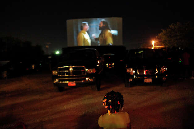 Myah Jones, 7, of Ft. Worth, watches Men in Black 3 at the Brazos Drive-in Theatre in Granbury on Saturday, August 11, 2012. Photo: Lisa Krantz, San Antonio Express-News / San Antonio Express-News
