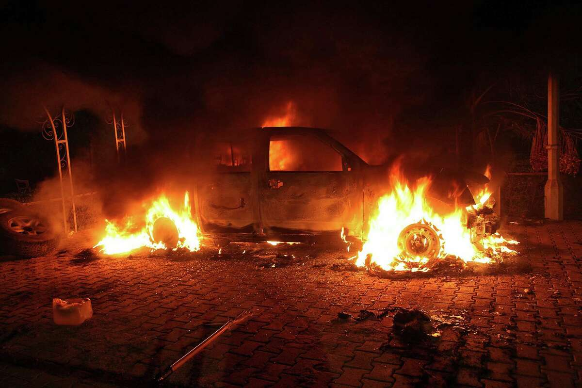 TOPSHOTS A vehicle and the surrounding area are engulfed in flames after it was set on fire inside the US consulate compound in Benghazi late on September 11, 2012. An armed mob protesting over a film they said offended Islam, attacked the US consulate in Benghazi and set fire to the building, killing one American, witnesses and officials said. AFP PHOTOSTR/AFP/GettyImages