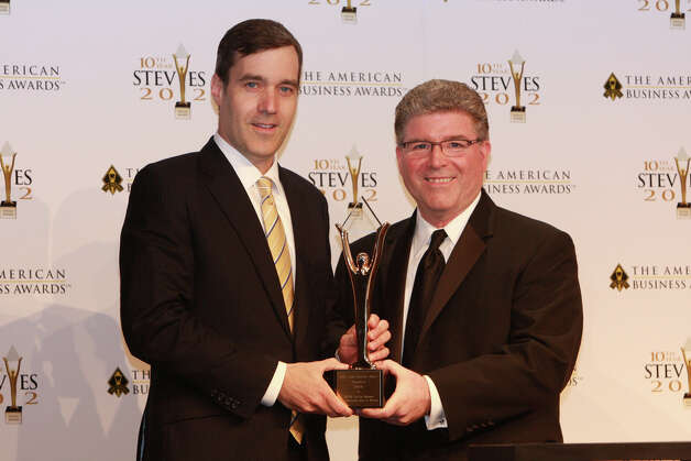 Norris Scott, left, accepts an award at the American Business Awards (ABAís) in New York City earlier this summer. NASCAR took home two awards for special events that were created by NASCAR for official partners. Photo: Contributed Photo