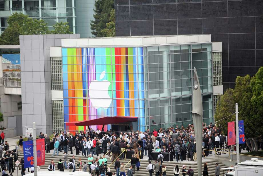 Journalists and attendees line up outside of Yerba Buena Center for the Arts in San Francisco to attend Apple's special media event to introduce the iPhone 5 on September 12, 2012 in California. AFP PHOTO/Kimihiro HoshinoKIMIHIRO HOSHINO/AFP/GettyImages Photo: KIMIHIRO HOSHINO, AFP/Getty Images / AFP