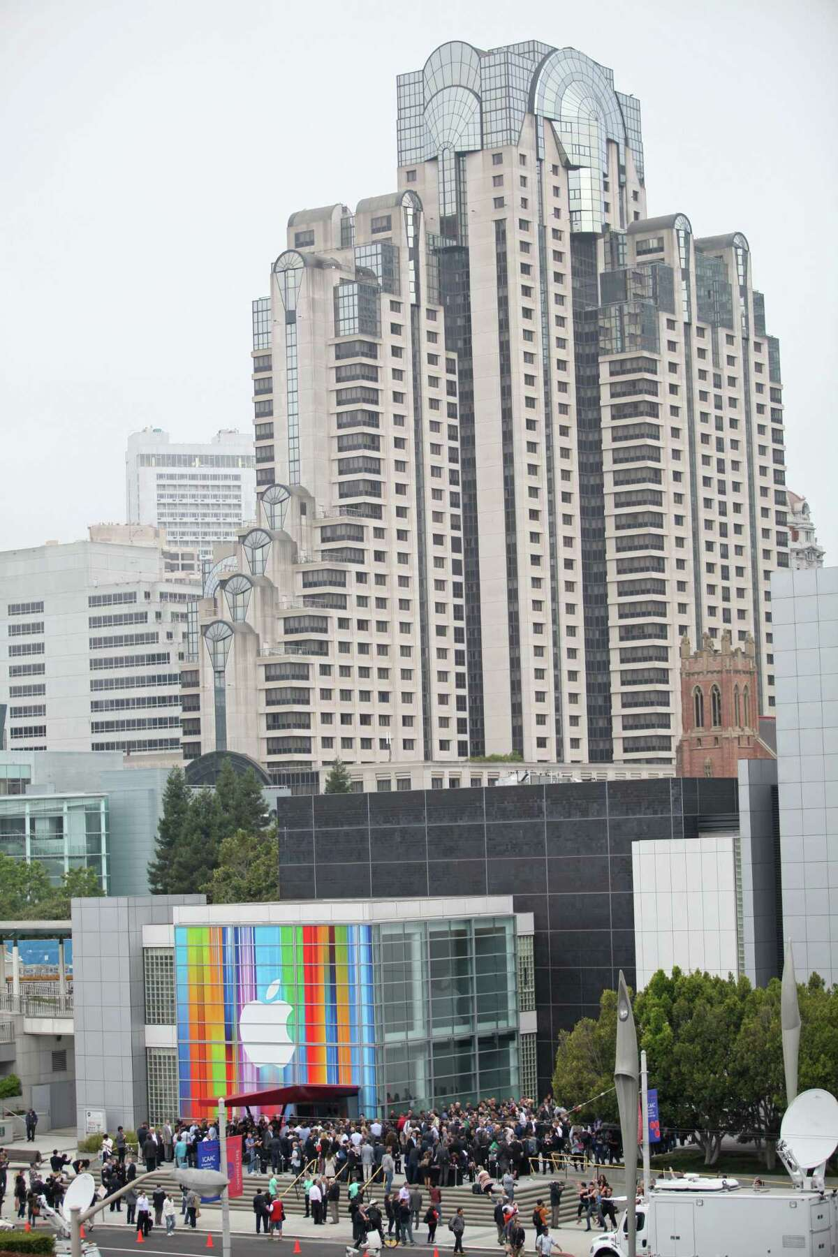 Journalists and attendees line up outside of Yerba Buena Center for the Arts in San Francisco to attend Apple's special media event to introduce the iPhone 5 on September 12, 2012 in California. AFP PHOTO/Kimihiro HoshinoKIMIHIRO HOSHINO/AFP/GettyImages