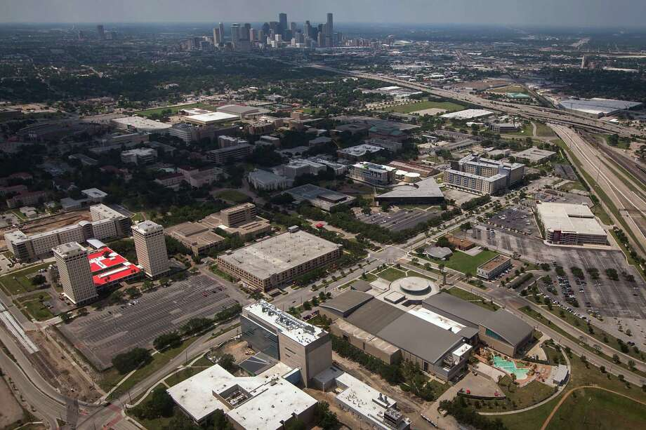 The University of Houston:The campus is seen at bottom with the downtown Houston skyline in an aerial photo taken May 26, 2012. Photo: Smiley N. Pool, Houston Chronicle / © 2012  Houston Chronicle