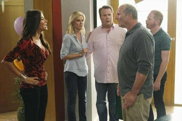 "MODERN FAMILY - Emmy and Golden Globe Award-winning ""Modern Family"" returns for its fourth season, WEDNESDAY, SEPTEMBER 26 (9:00-9:31 p.m., ET) on the ABC Television Network.  In the Season 4 premiere, ""Bringing Up Baby,"" Jay's birthday is upon us again and, as before, he makes it well-known that he wishes to keep it as low key as possible, with no grand gestures or surprises. But leave it to the family to miss the mark yet again! Phil takes Jay on a very unconventional fishing trip with his buddies, and Gloria struggles with how to break the pregnancy news to him. Meanwhile, Dylan moves into the Dunphy household temporarily, and Mitch and Cam decide to look into adopting a cat as they continue to cope with their failed attempt to adopt another child. (ABC/PETER ""HOPPER"" STONE)SOFIA VERGARA, JULIE BOWEN, ERIC STONESTREET, ED O'NEILL, JESSE TYLER FERGUSON (ABC)"