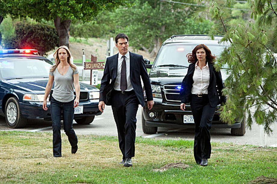 """The Silencer"""" JJ (A.J. Cook), Hotch (Thomas Gibson) and newest BAU member Alex Blake (Jeanne Tripplehorn) look at evidence as the BAU investigates the murder of a victim with the trademark handiwork of the UnSub Ã""The Silencer,"" who leaves behind victims with his unique trademark of sewing their mouths shut,  on the eighth season premiere of CRIMINAL MINDS, Wednesday, Sept. 26 (9:00-10:00 PM, ET/PT) on the CBS Television Network. Photo: Monty Brinton/CBS © 2012 CBS Broadcasting Inc. All Rights Reserved. Photo: Monty Brinton / ©2012 CBS Broadcasting Inc."
