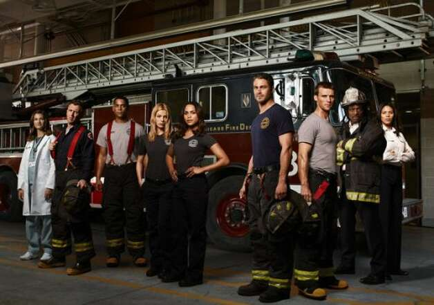 CHICAGO FIRE -- Season: Pilot -- Pictured: (l-r) Teri Reeves as Hallie, David Eigenberg as Christopher Hermann, Charlie Barnett as Peter Mills, Lauren German as Leslie Shay, Monica Raymund as Gabriella Dawson, Taylor Kinney as Kelly Severide, Jesse Spencer as Matthew Casey, Eamonn Walker as Battalion Chief Walter Boden, Merle Dandridge as Kay Fitori -- (Photo by: Sandro/NBC) (NBC / Sandro/NBC)