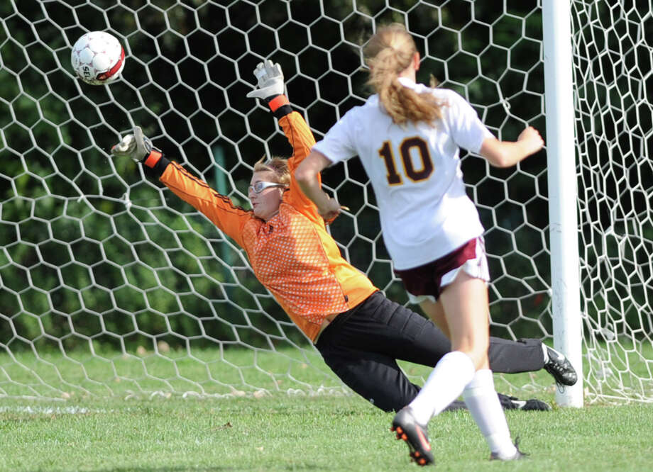Colonie goalie Courtney Yule lets the ball kicked by Bethlehem's Kaylee Rickert get by her during a soccer game Tuesday, Sept. 11, 2012 in Colonie, N.Y. (Lori Van Buren / Times Union) Photo: Lori Van Buren, Albany Times Union / 00019199A
