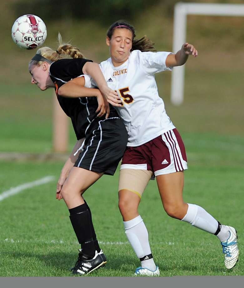 From left, Bethlehem's Samantha Taillon and Colonie's Emily Green battle for the ball during a soccer game Tuesday, Sept. 11, 2012 in Colonie, N.Y. (Lori Van Buren / Times Union) Photo: Lori Van Buren, Albany Times Union / 00019199A