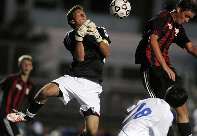 Fairfield Ludlowe goalie Ryan Arrigio battles for a loose ball with New Canaan's Nico Deambrosio during high school boys soccer action, in Fairfield, Conn. Sept. 11th, 2012. Each team began their 2012 soccer season last night. Photo: Contributed Photo / J. Gregory Raymond / New Canaan News freelance