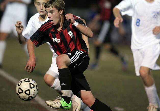 New Canaan forward Steven Valente advances the ball upfield against Fairfield Ludlowe during high school boys soccer action, in Fairfield, Conn. Sept. 11th, 2012. Photo: Contributed Photo / J. Gregory Raymond / New Canaan News freelance