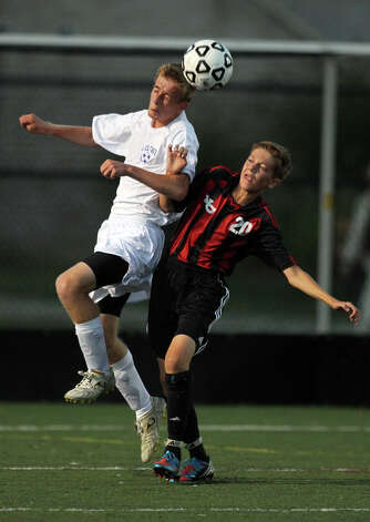 Fairfield Ludlowe's Mark Dubovskiy and New Canaan's Brett Capone try to control a head ball during high school boys soccer action, in Fairfield, Conn. Sept. 11th, 2012. Photo: Contributed Photo / J. Gregory Raymond / New Canaan News freelance