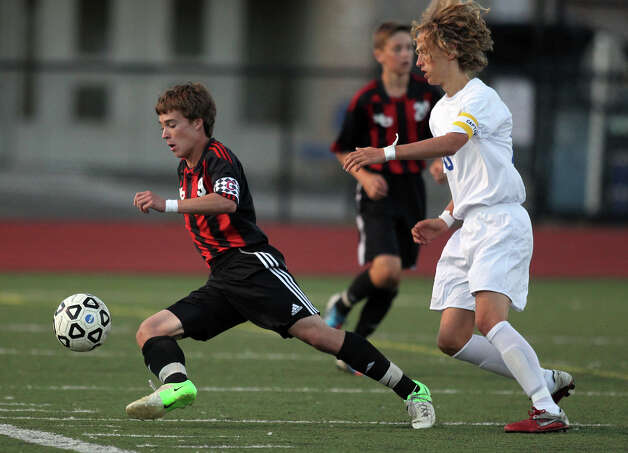 New Canaan's Steven Valente advances the ball upfield past Fairfield Ludlowe defender Tobias Gimand during high school boys soccer action, in Fairfield, Conn. Sept. 11th, 2012. Photo: Contributed Photo / J. Gregory Raymond / New Canaan News freelance