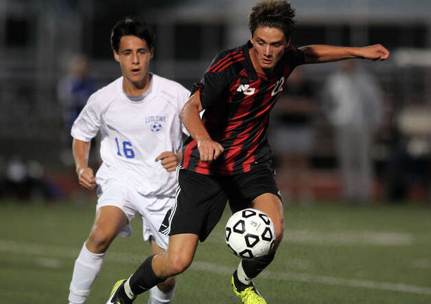 New Canaan's Nico Deambrosio dribbles the ball past Fairfield Ludlowe's Manuel Barral during high school boys soccer action, in Fairfield, Conn. Sept. 11th, 2012. Photo: Contributed Photo / J. Gregory Raymond / New Canaan News freelance