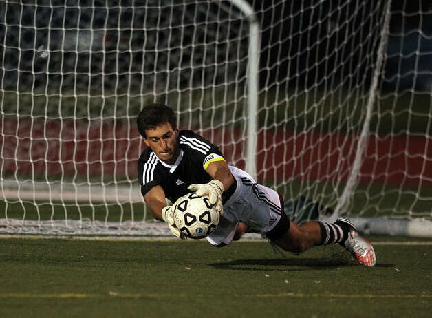Fairfield Ludlowe soccer goalie Ryan Arrigio dives to make a save against New Canaan during high school boys soccer action, in Fairfield, Conn. Sept. 11th, 2012. Photo: Contributed Photo / J. Gregory Raymond / New Canaan News freelance