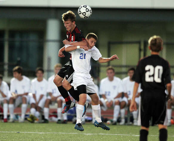 New Canaan's Keith Griffin and Fairfield Ludlowe's Billy Donatuti battle for a header during high school boys soccer action, in Fairfield, Conn. Sept. 11th, 2012. Photo: Contributed Photo / J. Gregory Raymond / New Canaan News freelance