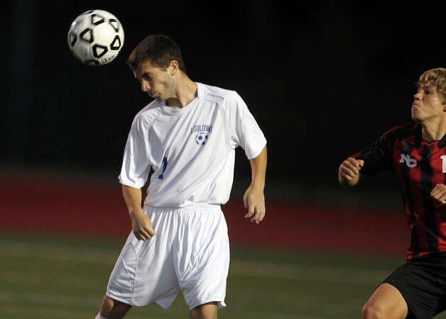 Fairfield Ludlowe's Richie Bellucci heads the ball upfield against New Canaan during high school boys soccer action, in Fairfield, Conn. Sept. 11th, 2012. Photo: Contributed Photo / J. Gregory Raymond / New Canaan News freelance