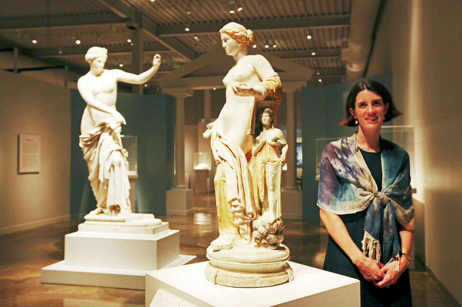 "San Antonio Museum of Art Gilbert M. Denman, Jr., Curator of Art of the Ancient Mediterranean World Jessica Power stands by part of the upcoming, ""Aphrodite and the Gods of Love,"" exhibit, Monday, Sept. 10, 2012. The exhibit was organized by the Boston Museum of Fine Arts and features seven pieces from the Museo Archeologico Nazionale in Naples, Italy. It runs from Sept. 25, 2012 to Feb. 17, 2013. Photo: Jerry Lara, San Antonio Express-News / © 2012 San Antonio Express-News"