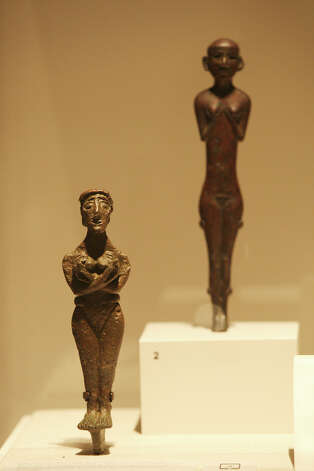 "A Levantine woman figure from 3200-2800 BC, left, and a Hittite woman figure from around 2000 BC are part of the San Antonio Museum of Art, ""Aphrodite and the Gods of Love,"" exhibit, Monday, Sept. 10, 2012. The exhibit was organized by the Boston Museum of Fine Arts and features seven pieces from the Museo Archeologico Nazionale in Naples, Italy. It runs from Sept. 25, 2012 to Feb. 17, 2013. Photo: Jerry Lara, San Antonio Express-News / © 2012 San Antonio Express-News"