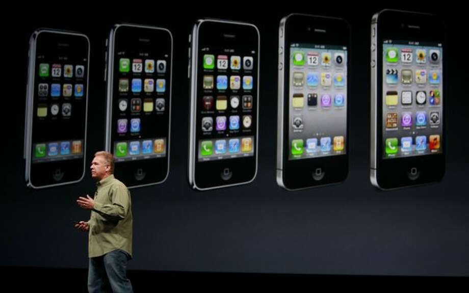Apple's senior vice president of Worldwide Marketing, Philip Schiller introduces the new iPhone 5 at the Yerba Buena Center for the Arts on Wednesday Sep. 12, 2012 in San Francisco, Calif. The new phone features a larger screen a faster network and an updated operating system called iOS6. (Mike Kepka / The Chronicle)