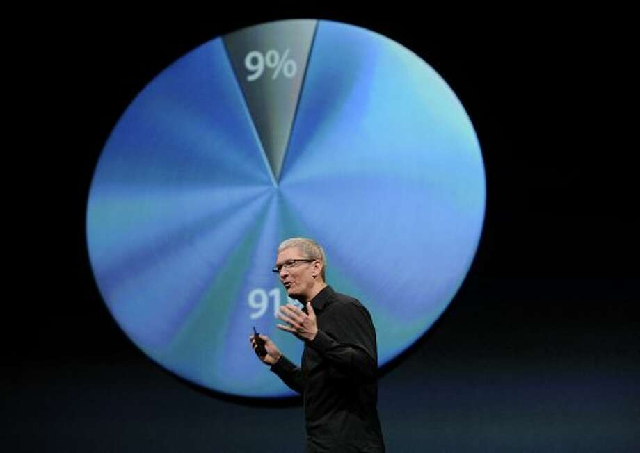 Tim Cook, chief executive officer of Apple Inc., speaks during an event in San Francisco, California, U.S., on Wednesday, Sept. 12, 2012. Apple Inc. unveiled the iPhone 5 in an overhaul aimed at widening its lead over Samsung Electronics Co. and Google Inc. in the $219.1 billion smartphone market. (David Paul Morris / Bloomberg)