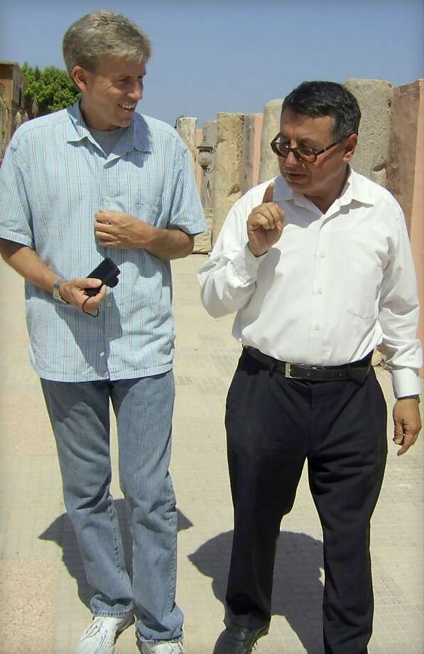In this photo posted on the U.S. Embassy Tripoli Facebook page on Aug. 27, 2012, U.S. Ambassador to Libya Christopher Stevens, left, walks with an unidentified translator during a tour of Assaraya al-Hamra, or the Red Castle in Tripoli, Libya. Photo: U. S. Embassy Tripoli, Associated Press