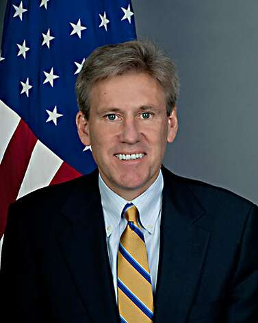 This US State Dperatment official photo obtained September 12, 2012 shows US ambassador to Libya J. Christopher Stevens.  The American ambassador to Libya, J. Christopher Stevens, and three officials were killed when a mob attacked the US consulate in the eastern city of Benghazi, the interior ministry said Wednesday. The envoy died when an armed mob protesting against a film deemed offensive to Islam attacked the US mission, just hours after Islamists also stormed Washington's embassy in the Egyptian capital Cairo. Stevens, a career officer with the US foreign service, had been in the country for less than four months after taking up his post in the capital Tripoli in May. Photo: US State Dept., AFP/Getty Images