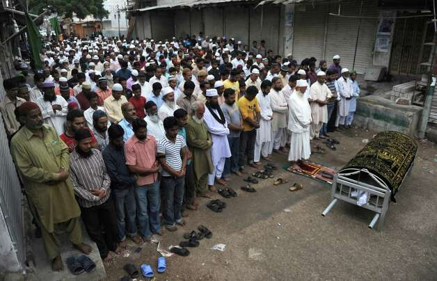 Pakistani Muslims offer funeral prayers for a garment factory worker following a fire in the garment factory in which at least 280 people died in Karachi on September 12, 2012.  Photo: RIZWAN TABASSUM, AFP/Getty Images / AFP