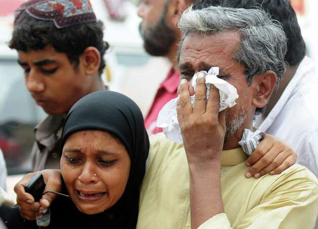 Relatives mourn the death of Pakistani garment factory workers outside a garment factory following a fire in which at least 280 people died in Karachi on September 12, 2012.  Photo: RIZWAN TABASSUM, AFP/Getty Images / AFP