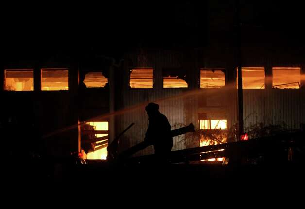 A fireman tries to extinguish a fire which broke out in a factory on Tuesday, Sept. 11, 2012 in Karachi, Pakistan.  Photo: Shakil Adil, Associated Press / AP