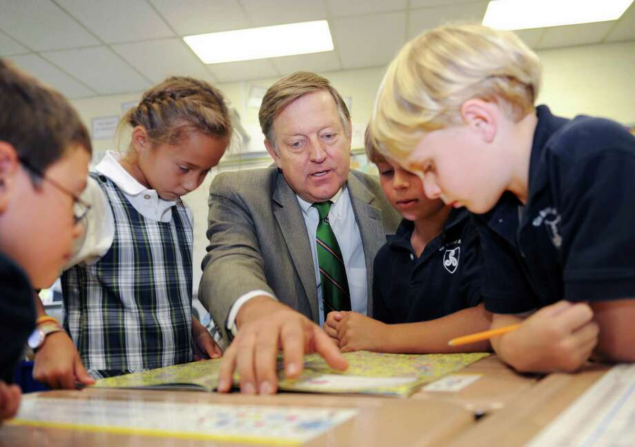 Paul Geise, Stanwich School's new head of school visits with second graders from left, Hayden Kuppenheimer, Grace Althoff, Jack Karst and Todd Rosenbaum Wednesday, Sept. 12, 2012. Photo: Helen Neafsey / Greenwich Time