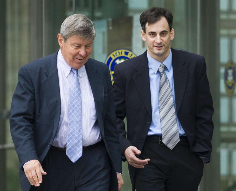 Norwalk police officer Anthony Santo, right, walks out of his arraignment at the Stamford Courthouse with his attorney Peter Truebner, left, in October 2009. Santo was arraigned on charges of second-degree assault and risk of injury to a minor. Photo: Kathleen O'Rourke / Stamford Advocate