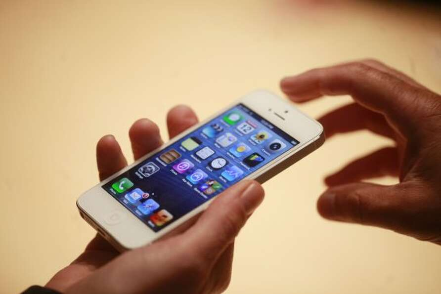 Members of the media get a hands-on look at the iPhone 5 after Apple introduced an improved line of