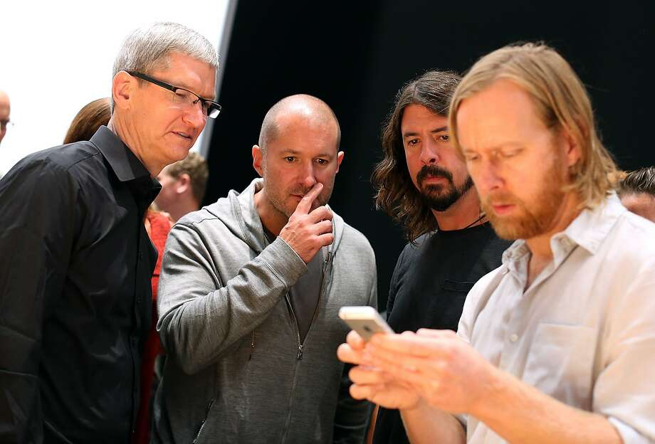 SAN FRANCISCO, CA - SEPTEMBER 12:  (L-R) Apple CEO Tim Cook, Apple senior vice president of Industrial Design Jonathan Ive and Dave Grohl of the Foo Fighters look on as an attendee looks at the new iPhone 5 during an Apple special event at the Yerba Buena Center for the Arts on September 12, 2012 in San Francisco, California. Apple announced the iPhone 5, the latest version of the popular smart phone.  (Photo by Justin Sullivan/Getty Images) Photo: Justin Sullivan, Getty Images