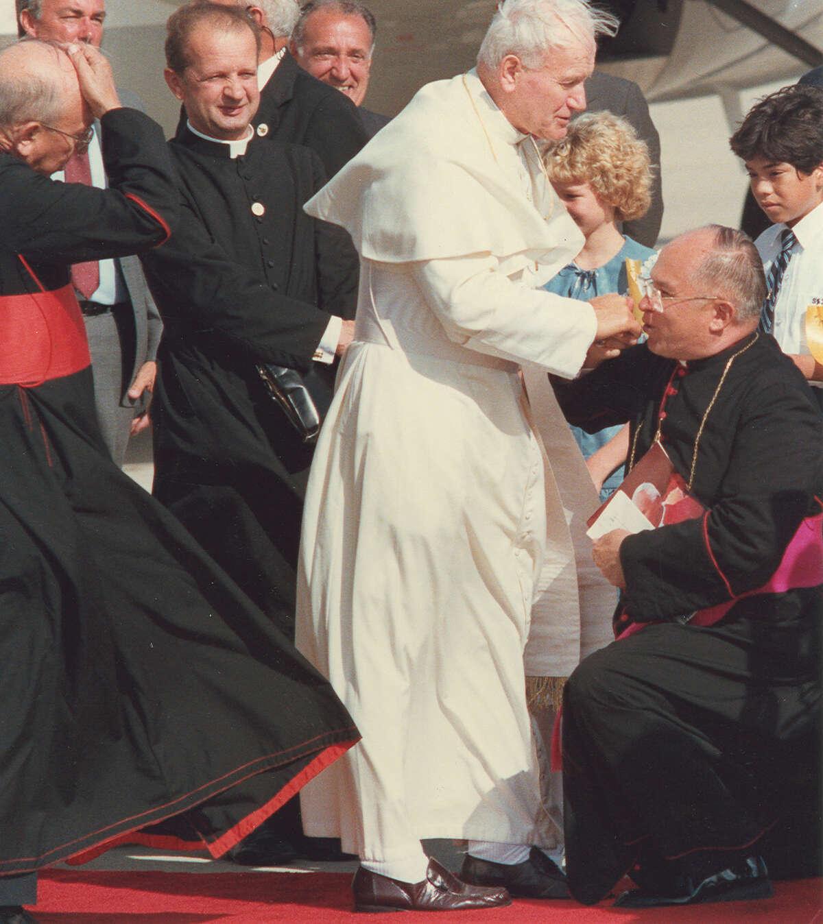 Archbishop Patrick Flores greets Pope John Paul II at Kelly Air Force Base September 13, 1987.