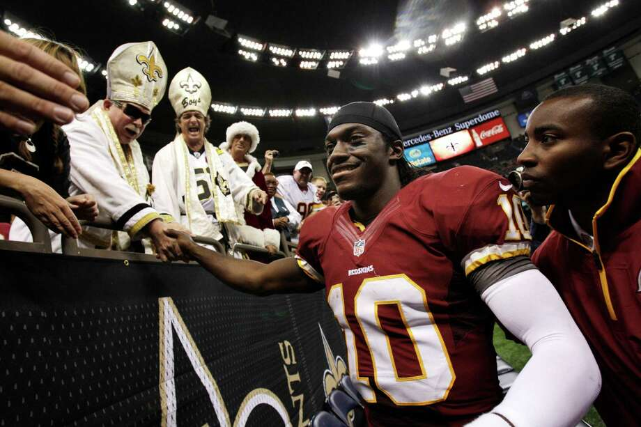 Robert Griffin III had reason to be all smiles after his electric NFL debut in a 40-32 victory over the Saints. Photo: Matthew Hinton, Associated Press / FR170690 AP