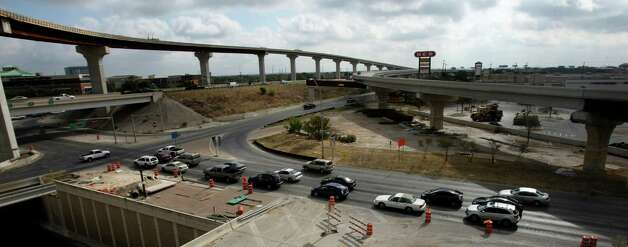 Traffic stopped on the frontage road of northbound U.S. 281 as construction continues on the Loop 1604 and U.S. 281 interchange as seen on Wednesday Sept. 12, 2012. Photo: Helen L. Montoya, San Antonio Express-News / ©SAN ANTONIO EXPRESS-NEWS