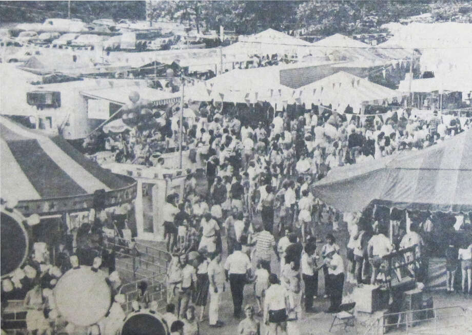 The Festival Italiano in Saugatuck packed 'em in on the day this photo was shot in 1984. A shortage of volunteers sounded the death knell for the fest, but Saugatuck now is showing signs of new life. Photo: Contributed Photo, ST / Westport News