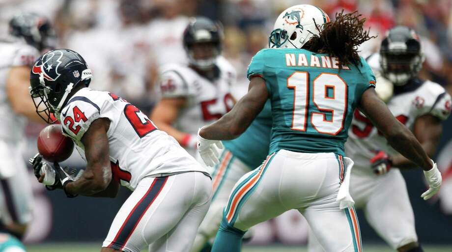Texans cornerback Johnathan Joseph (left) comes up with a pass intended for Miami's Legedu Naanee, one of three Houston interceptions in Sunday's win. Photo: Brett Coomer, Houston Chronicle / © 2012  Houston Chronicle