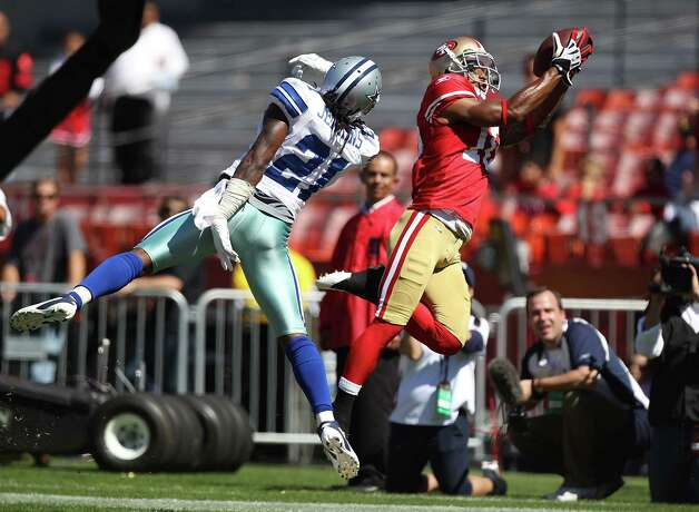SAN FRANCISCO, CA - SEPTEMBER 18:   Kyle Williams #10 of the San Francisco 49ers catches a touchdown over Mike Jenkins #21 of the Dallas Cowboys at Candlestick Park on September 18, 2011 in San Francisco, California. Photo: Jed Jacobsohn, Getty Images / 2011 Getty Images