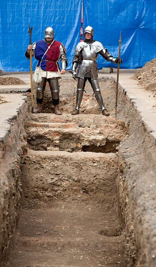 Men dressed as medieval knights stand at the possible grave site of King Richard III. Photo: Gavin Fogg, AFP/Getty Images