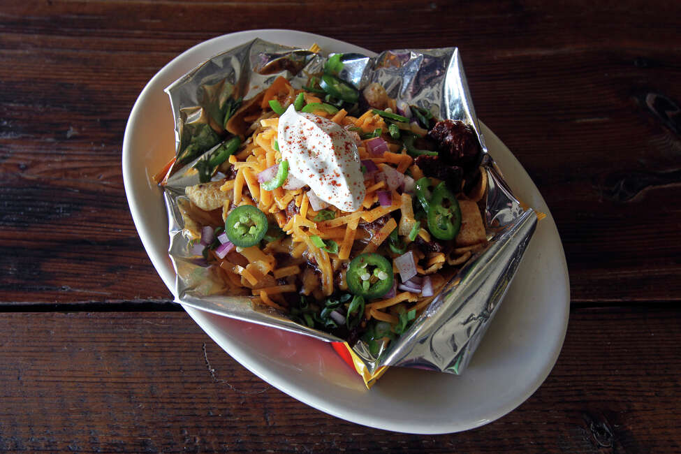 Frito Pie served in a bag: For those who reside just north of San Antonio, the Phoenix Saloon in New Braunfels serves the classic dish just like it was meant to be served - in a bag. The snack costs $6.