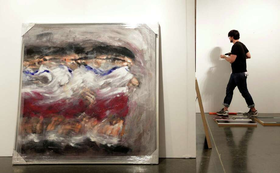 """Contra Corriente"" (Against the Current) is a painting by Dayron Gonzalez in the Cernuda Arte Gallery waiting to be installed at the Houston Fine Art Fair at Reliant Center on Wednesday, Sept. 12, 2012, in Houston. Photo: Mayra Beltran, Houston Chronicle / © 2012 Houston Chronicle"