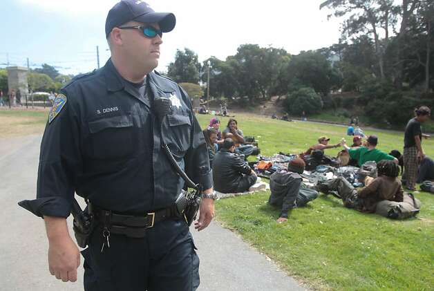Officer Sean Dennis patrols the Golden Gate Park entrance where drug dealers have been conducting business. Photo: Mathew Sumner, Special To The Chronicle