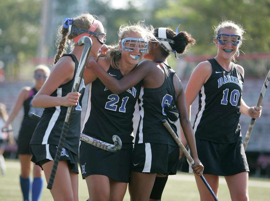 Darien field hockey player, Erika Osherow (center) is congratulated by teammates following Osherow's goal, the third of the game for Darien. The Blue Wave beat New Canaan, 4-0  in New Canaan, Conn. on Wednesday, Sept. 12, 2012. Photo: J. Gregory Raymond / Stamford Advocate Freelance;  © J. Gregory Raymond/for The Advocate