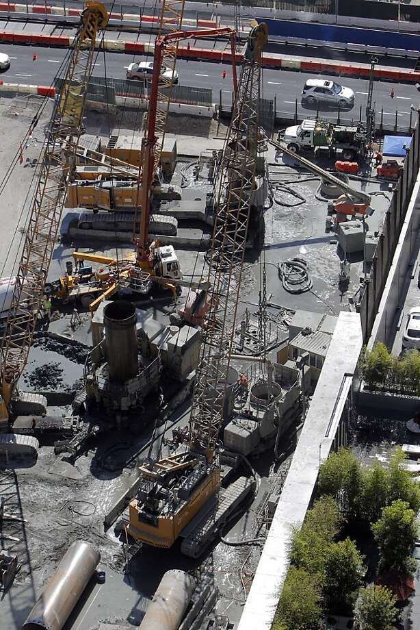 Crane operator Brandon Valasik (not shown) unearthed parts of the remains of a wooly mammoth with his crane (lower center) seen in the work area  Wednesday, September 12, 2012, in San Francisco, Calif., at the site of the new Transbay Terminal. Photo: Carlos Avila Gonzalez, The Chronicle