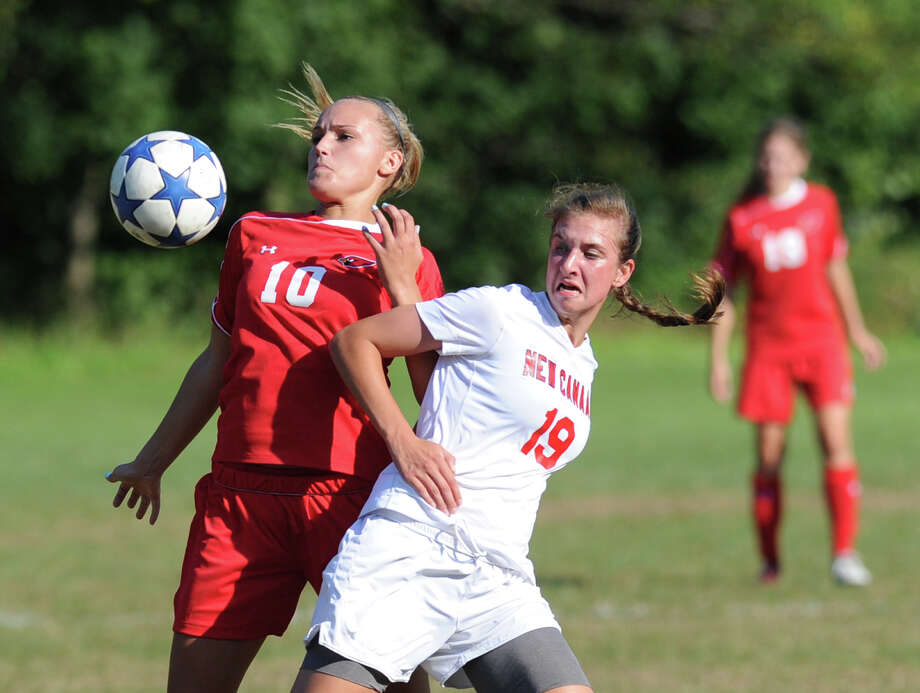 At left, Emily Johnson # 10 of Greenwich, and Anna Borea # 19 of New Canaan, go for the ball during the girls high school soccer match between Greenwich High School and New Canaan HIgh School at New Canaan, Wednesday, Sept. 12, 2012. Photo: Bob Luckey / Greenwich Time