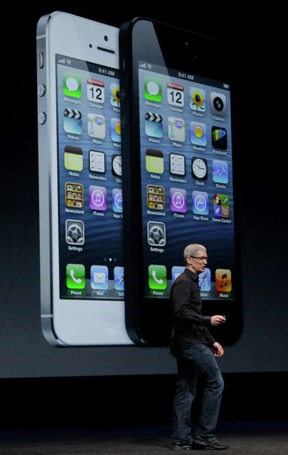 Apple CEO Tim Cook speaks in front of an image of the iPhone 5 during an Apple event in San Francisco, Wednesday, Sept. 12, 2012. (AP Photo/Jeff Chiu) Photo: Jeff Chiu