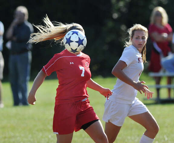 The ball appears to replace the head of Molli Haimerl # 7 of Greenwich, in an optical illusion in this photo taken during the girls high school soccer match between Greenwich High School and New Canaan HIgh School at New Canaan, Wednesday, Sept. 12, 2012. New Canaan won 3-1. Photo: Bob Luckey / Greenwich Time