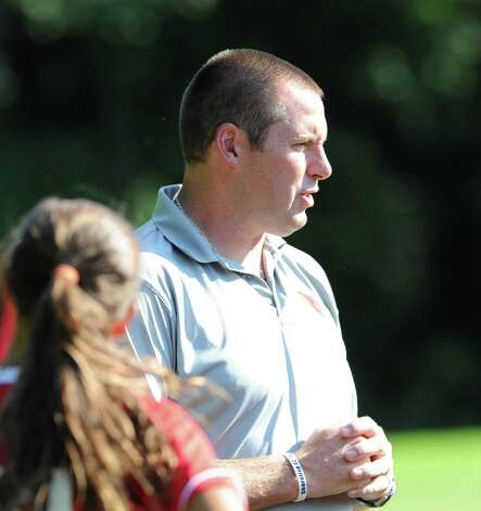 Greenwich High School girls soccer coach Danny Simpson during the girls high school soccer match between Greenwich High School and New Canaan HIgh School at New Canaan, Wednesday, Sept. 12, 2012. Photo: Bob Luckey / Greenwich Time