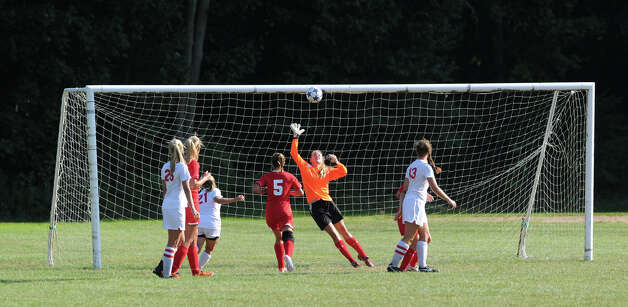Greenwich goalie Kylie Ginsberg fails to stop a goal by New Canaan's Anna Borea during the girls high school soccer match between Greenwich High School and New Canaan HIgh School at New Canaan, Wednesday, Sept. 12, 2012. New Canaan won 3-1. Photo: Bob Luckey / Greenwich Time