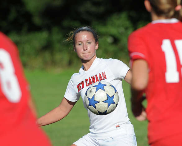 Eileen Dinnie # 14 of New Canaan during the girls high school soccer match between Greenwich High School and New Canaan HIgh School at New Canaan, Wednesday, Sept. 12, 2012. Photo: Bob Luckey / Greenwich Time